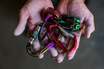 austin rock gym carabiners karabiners belay devices chalk rock climbing climbers hands