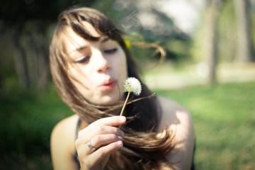 dandelion woman girl blowing wind seeds spring flower
