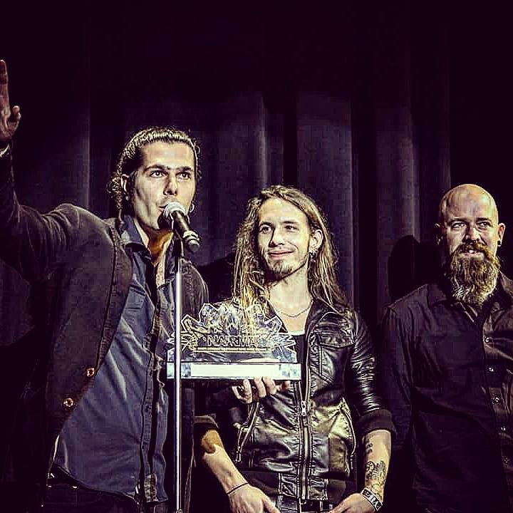 """<I>Seek Irony accepting Album of the Year at the North American Independent Rock Music Awards in 2016. <a href=""""https://www.facebook.com/SeekIrony/photos/pb.6430439063.-2207520000.1458154326./10153576689149064/?type=3&theater"""" target=""""_blank"""">Photo via Facebook</a>.</I>"""