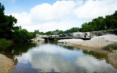 Jump Into McKinney Falls State Park's Lower Falls To Beat The Heat