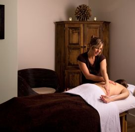 Female massage therapist treats a female patient at Viva Day Spa in Austin, Texas.
