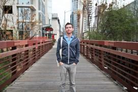 man on walking bridge in downtown Austin