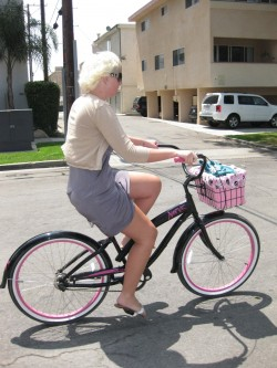 "Riding her pink ""Nirve"" bike"