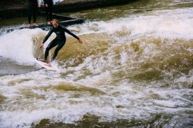 Surfing on the Eisbach river in the Englischer Garten