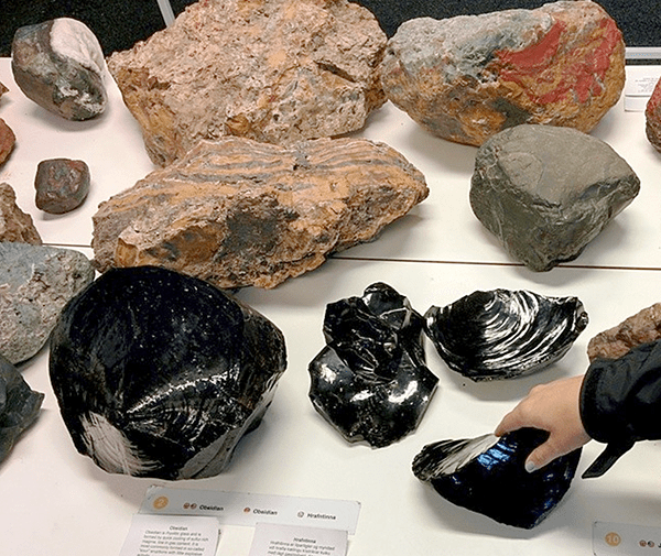 Touching all the rocks at the volcano museum