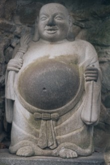 Rubbing Buddha's belly for luck