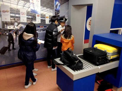 Students Role-playing as Security Guards and Passengers in the airport