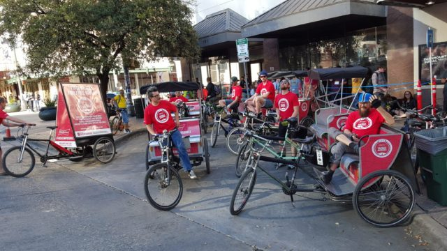 Pedicabs and sign trikes on the scene. Ready to give out free rides next to a active venue during SXSW.