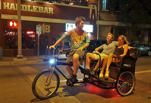 Adam on a MetroPCS cab riding through 5th st. outside of Handlebar Bar