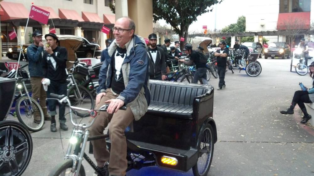 Ken Cameron on a pedicab in Austin, Texas.