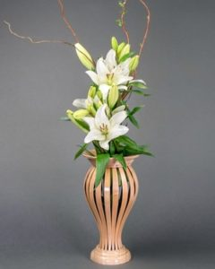 Curved wooden flower vase by Aaron Fox
