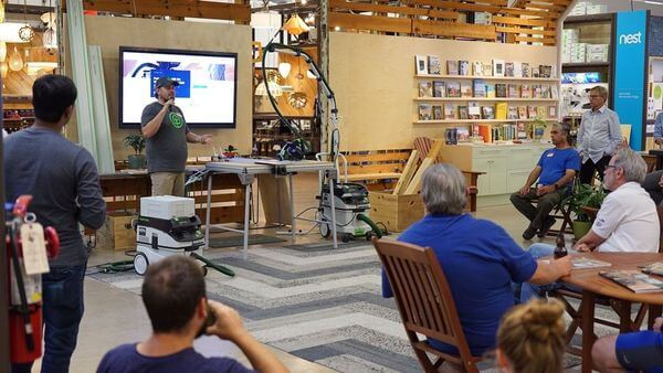 woodworkers watching a demonstration of tools by festool