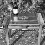 wine bottle and glass on custom furniture side table