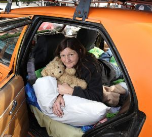 Jacqueline Carter on her bed in the back of her car.