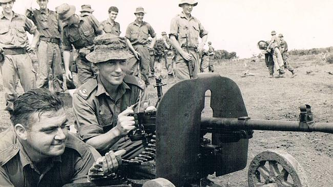 Jack Kirby and Harry Smith with a captured enemy machinegun