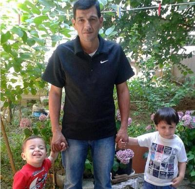 Aylan Kurdi happy with his father and brother