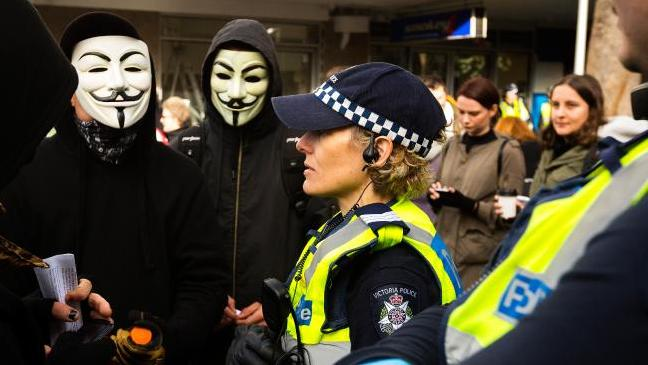 Anarchists wearing Guy Fawkes masks