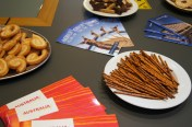 Table full of snacks and information material about Australia with a kangaroo on the cover