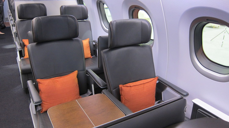 The mockup's business class seats are configured in a staggered format.