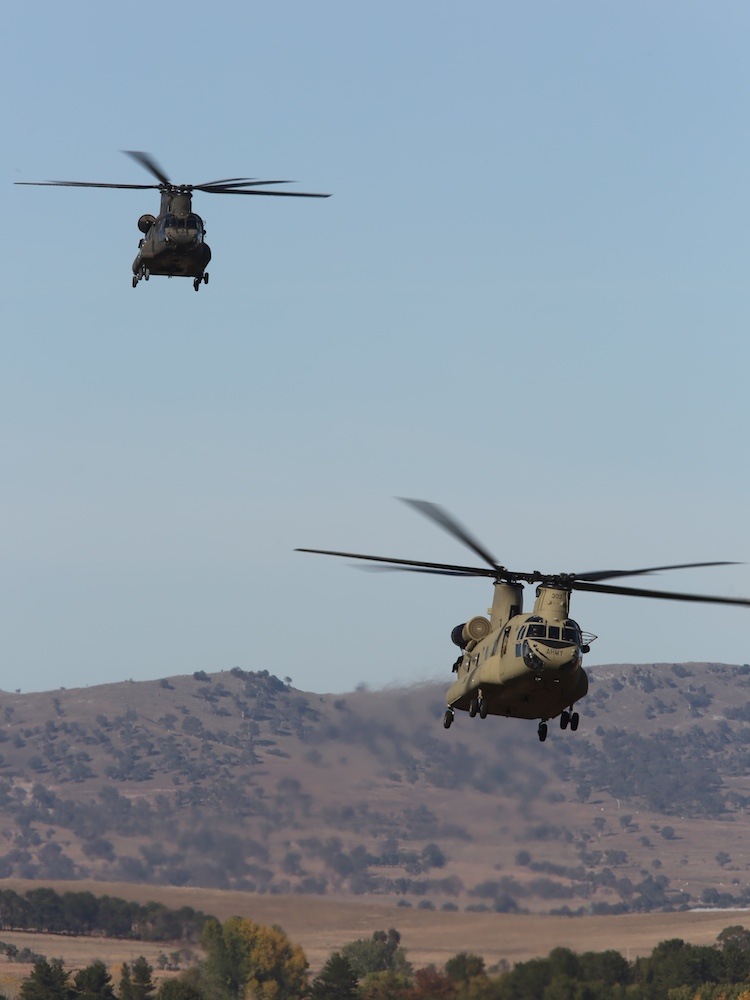 Army CH-47D Chinook, A15-202 and CH-47F, A15-303, on approach to Air Force's 34SQN, Fairbairn. (Paul Sadler)
