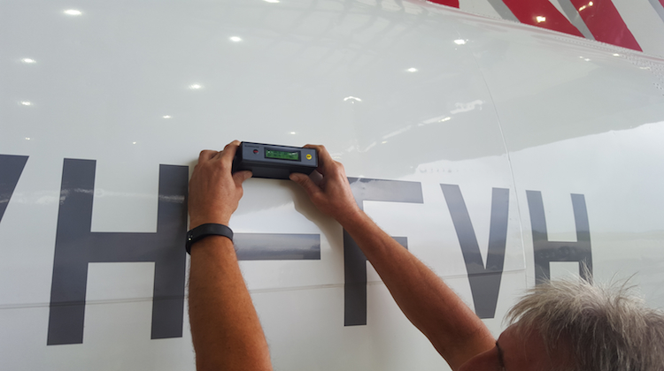 A member of the Permagard team measuring the gloss reading on the aircraft. (Permagard)