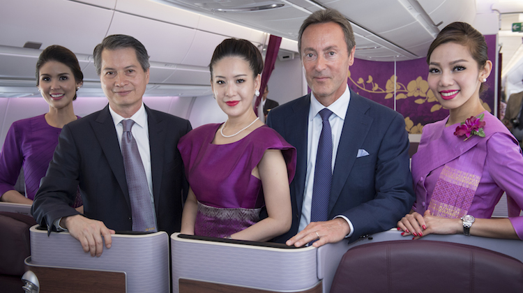 Thai Airways president Charamporn Jotikasthira and Airbus chief executive Fabrice Bregier pose on board of the airline's first A350. (Airbus)