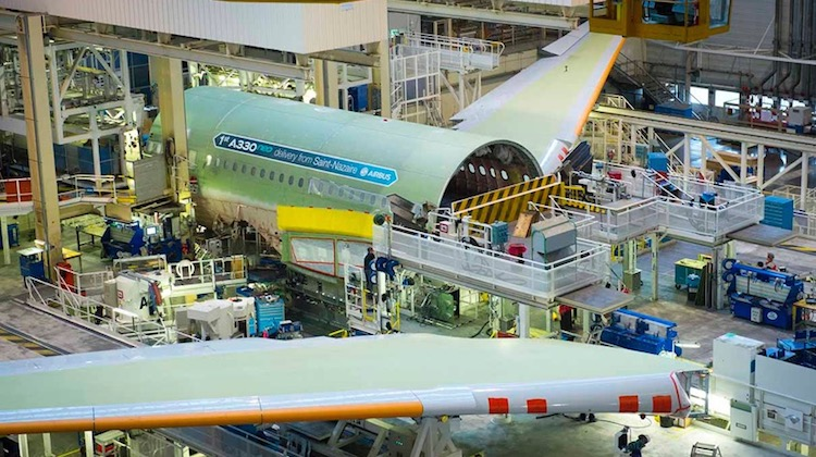 The wings are joined to the fuselage during final assembly of the first A330neo. (Airbus)