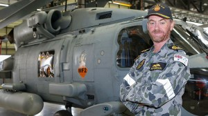 AMAFTU Officer In Charge Commander David Hutchinson stands in front of a MH-60R Seahawk 'Romeo' at 725 Squadron. (Defence)