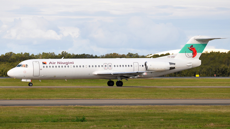 A file image of Air Niugini Fokker 100 P2-AND at Brisbane Airport. (Wikimedia Commons/Robert Frola)