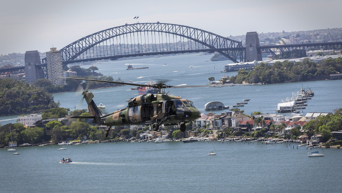 A 6th Aviation Regiment S-70A-9 Black Hawk flies out of Sydney Harbour. (Defence)