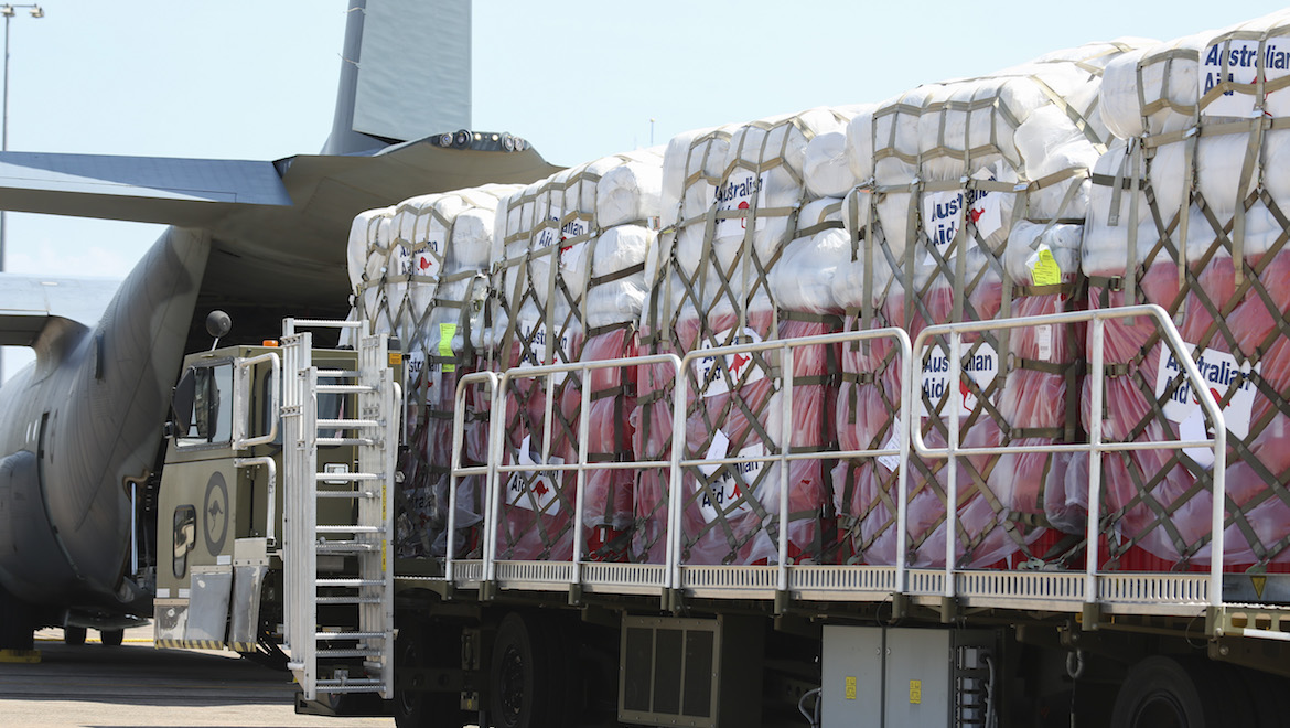 Humanitarian aid is loaded onto a Royal Australian Air Force C-130J Hercules at RAAF Base Darwin. (Defence)