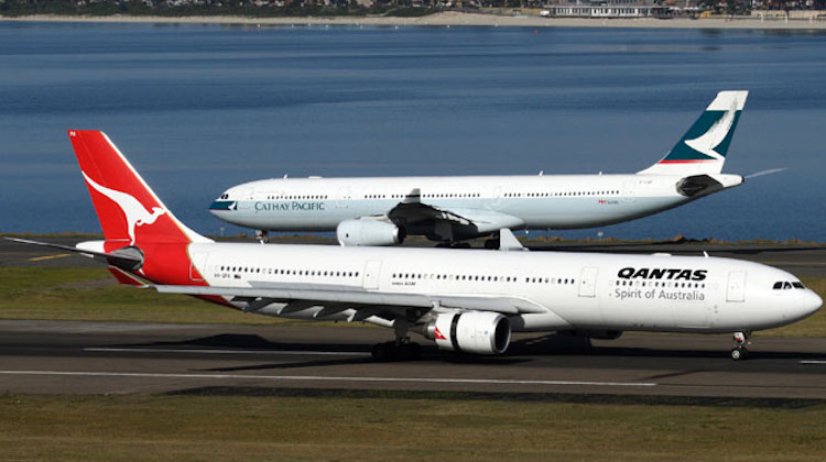 A pair of Airbus A330s from Cathay Pacific and Qantas at Sydney Airport. (Rob Finlayson)