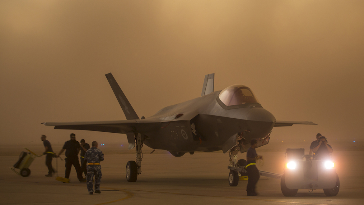 A RAAF F-35 is towed to shelter at Luke during a dust storm. (Defence)