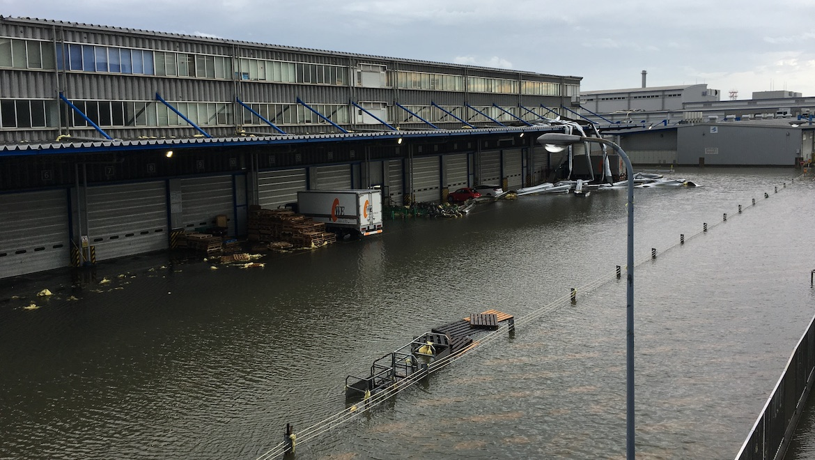 Winds tore roofs and shutters away from the cargo warehouse precinct. (Kansai Airports)