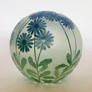 Daisy paperweight (blue green) by Amanda Louden. Blown and etched glass.