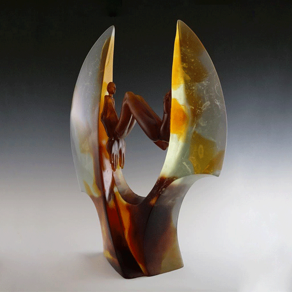 Envelop by Crystal Stubbs. Hot Sculpted glass figure and cast lead crystal sculpture