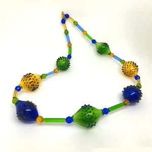Art Deco flame formed necklace by Susie Barnes. Green, blue and gold.