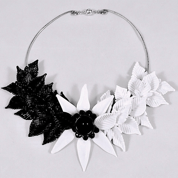 'Equinox' by Jennie Merritt. Flame formed glass leaves on silver plated wire with magnetic clasp.