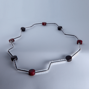 Zig Zag necklace (large) by Susie Barnes. Red, black and clear with white overlay.
