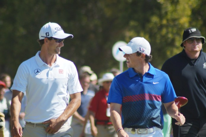 Rory McIlroy and Adam Scott during the final round of the 2013 Australian Open