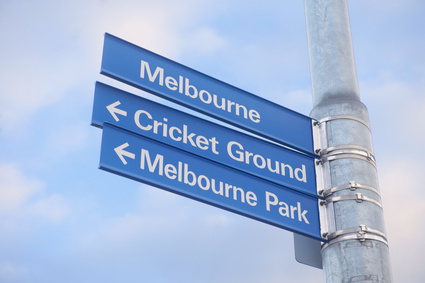 Street sign in Melbourne indicating direction to the cricket ground