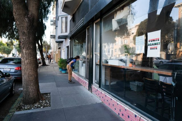 Caroline Whatley looking into the window of the Tartine Bakery
