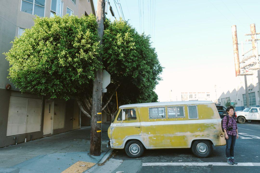 Yellow Ford Econoline van in San Francisco