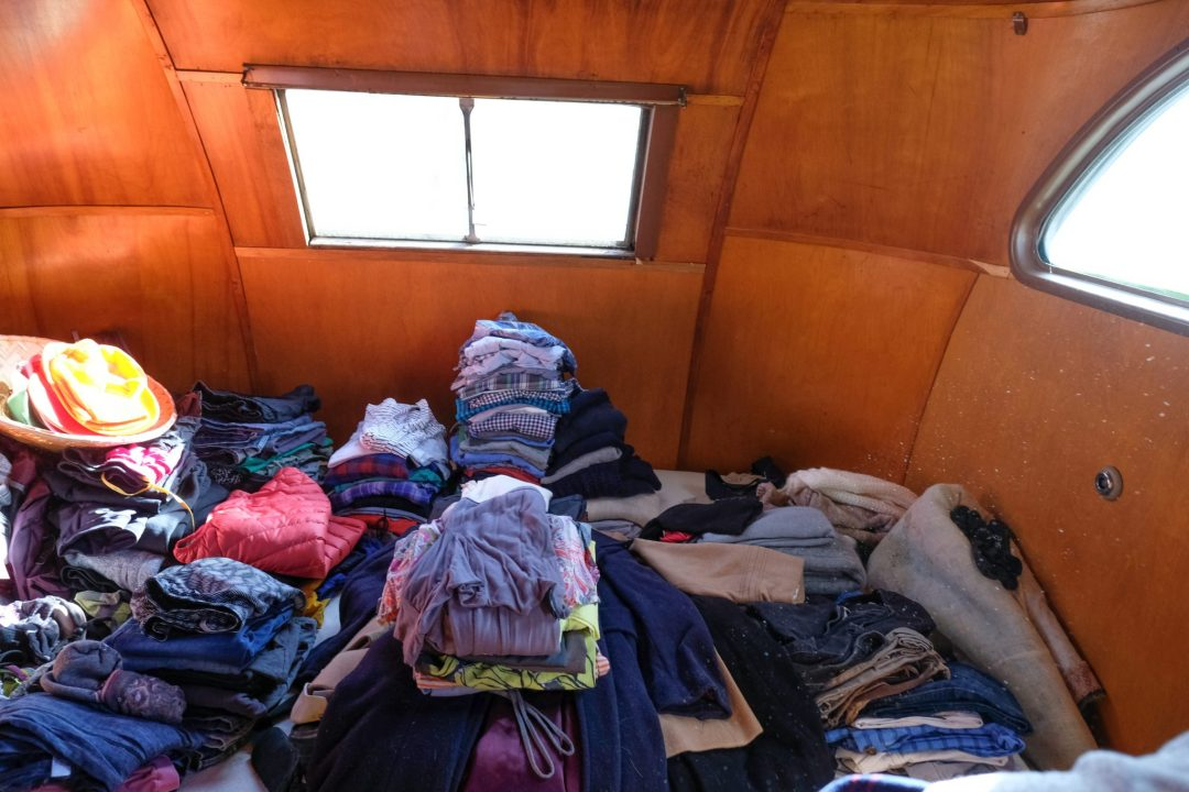A photo of the inside of a travel trailer of someone who is downsizing their home.
