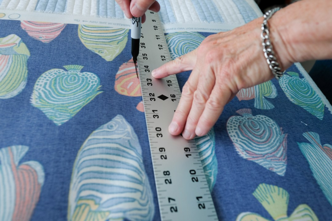 measuring fabric for a storage bag