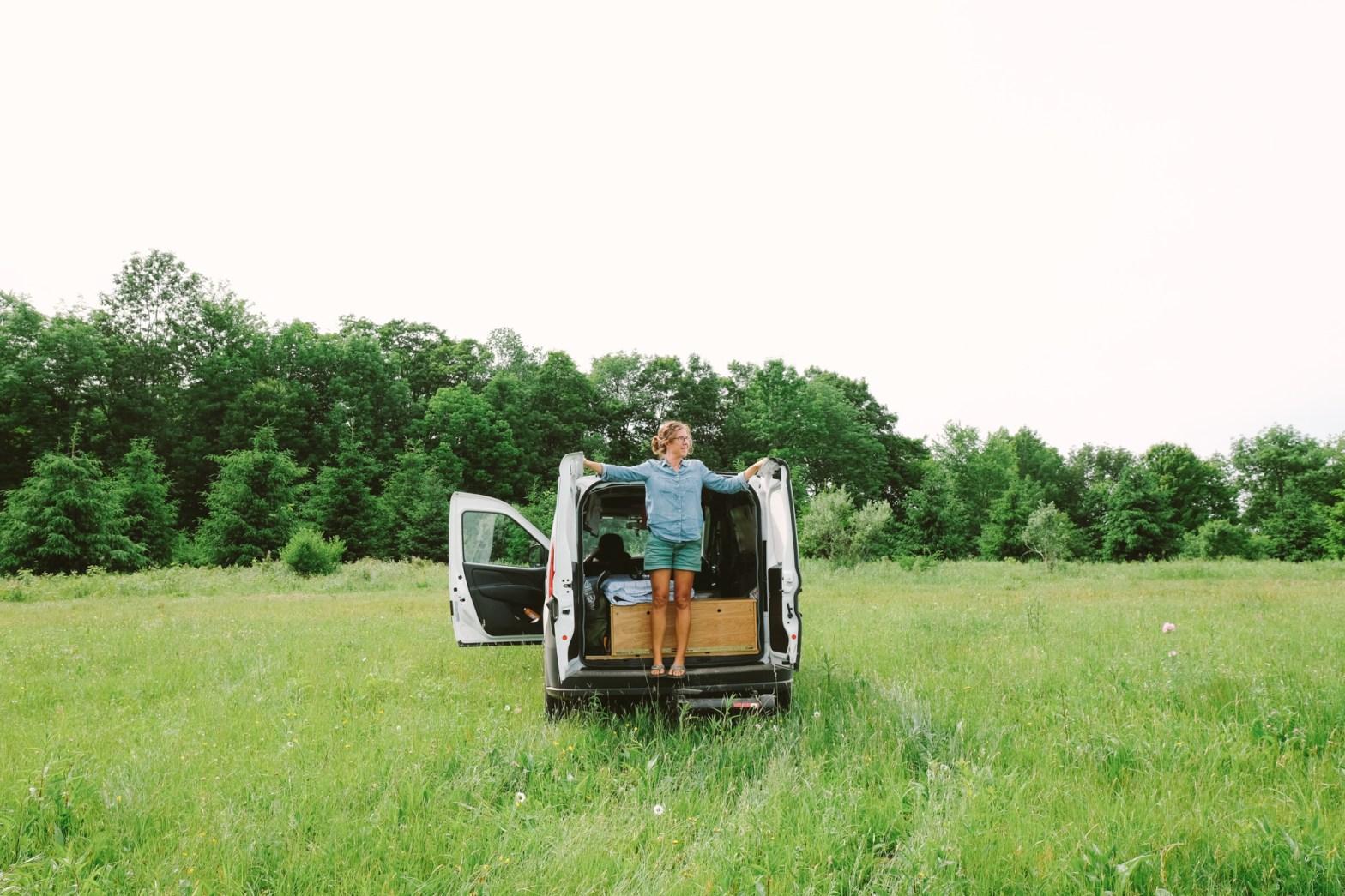 Caroline Whatley standing in the back of an open Ram Promaster camper van