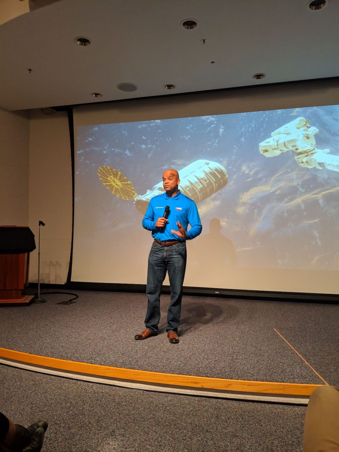 A photo of Astronaut Robert Curbeam talking to the group about the NG-11 mission.