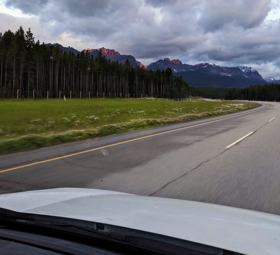 mountain sunrise from inside a van in Banff National Park