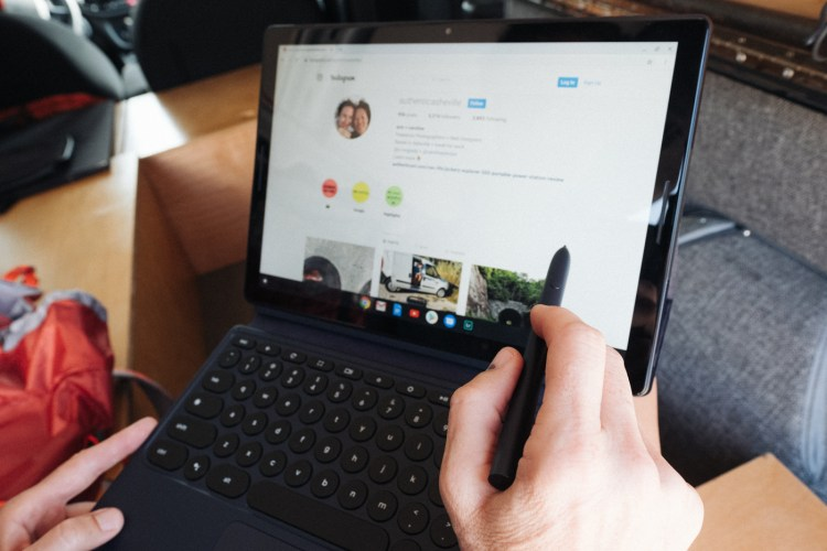 photo of a person using the Google Pixel Slate and Pen