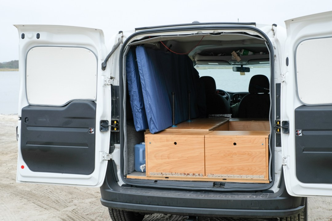The back of a Ram Promaster City with a Wayfarer Camper Van Conversion Kit and a DIY Bed